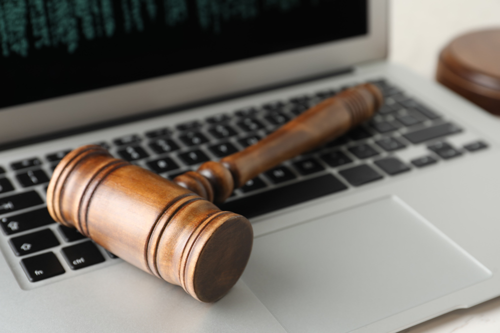 Image of gavel on a laptop at the hompage of the Nigerian Law Forum